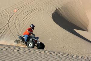 quad atv rider - sand dunes